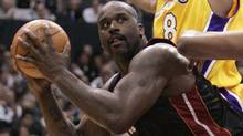 Miami Heat's Shaquille O'Neal looks for a shot during the first half of NBA basketball action in Los Angeles, Monday, Jan. 16, 2006. (MATT SAYLES/AP)