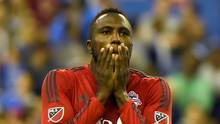 Toronto FC forward Jozy Altidore (17) reacts after missing a scoring chance in the second half of a 3-2 loss to Montreal Impact in the first leg of the MLS Eastern Conference Championship at Olympic Stadium. (Dan Hamilton/USA Today Sports)
