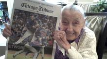 Chicago Cubs fan Helen Weithman celebrates the team's World Series victory at her home in Glen Ellyn, Ill. on Nov. 4, 2016, in this photo provided by the Strobel family. (Elizabeth Strobel/via The Associated Press)