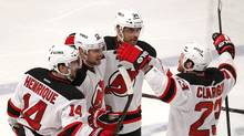 New Jersey Devils' David Clarkson (R) celebrates with teammates Adam Henrique (L), Alexei Ponikarovsky (2nd from L) and Bryce Salvador after scoring against the New York Rangers in the third period of Game 2 of the NHL Eastern Conference Finals at Madison Square Garden in New York, May 16, 2012. REUTERS/ (Mike Segar/Reuters/Mike Segar/Reuters)