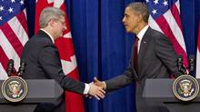 Prime Minister Stephen Harper shakes hands with U.S. President Barack Obama after a joint news conference in Washington on Feb. 4, 2011. (Sean Kilpatrick/THE CANADIAN PRESS)