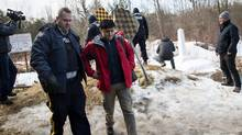 A man claiming to be from Turkey is arrested by Royal Canadian Mounted Police officers after he crossed the U.S.-Canada border on Feb. 23, 2017 in Hemmingford, Quebec. (Drew Angerer/Getty Images)