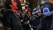 An Occupy Wall Street protester yells out at police after being ordered to leave Zuccotti Park in New York. (Mary Altaffer/AP/Mary Altaffer/AP)