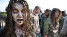 "In this image released by AMC, zombies appear in a scene from the second season of the AMC original series, ""The Walking Dead,"" in Senoia, Ga. (Gene Page/AP)"