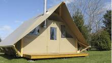One of Parks Canada's yurts, a tent-like structure mounted on a wooden deck floor. (Parks Canada)