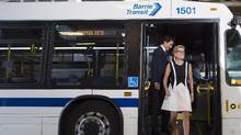 Prime Minister Justin Trudeau, left, and Ontario Premier Kathleen Wynne ride a city bus before making an announcement regarding new funding for transit in Barrie, Ont., on Tuesday, August 23, 2016. (Nathan Denette/THE CANADIAN PRESS)