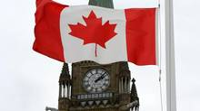 A Canadian flag blows in front of the Peace Tower on Parliament Hill in Ottawa, Ont., Wednesday, Oct. 24, 2012. (CP)