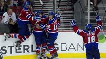 Edmonton celebrates their second goal in the second period scored by Stephane Legault (7) to give the Oil Kings a 4-2 lead going into the final period in game 4 of the Western Hockey League Championship playoffs at the Rose Garden, Tuesday May 8, 2012. (Doug Beghtel/AP/Doug Beghtel/AP)