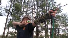 Learn the fundamentals of shooting a bow and arrow with the Hunger Games Fan Tour in Brevard, N.C. (Sarah MacWhirter/Sarah MacWhirter/The Globe and Mail)
