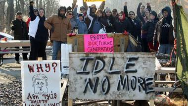 People from Aamjiwnaang First Nation and supporters gather for a meeting with officials as their blockade of the CN St. Clair spur line that began Friday, continues in Sarnia, Ont., Sunday, December 23, 2012.