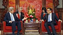 U.S. Secretary of State John Kerry, left, speaks with Premier Li Keqiang of China during a meeting at Zhongnanhai, the central government compound in Beijing, April 13, 2013. (JASON LEE/NYT Pool)