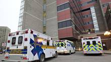 Ambulances wait outside the emergency entrance at the University of Alberta Hospital in Edmonton in this photo from 2012. (JASON FRANSON For The Globe and Mail)