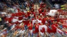 Canada fans cheer during the Davis Cup semifinal tennis match in Belgrade, Serbia (Associated Press)