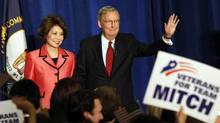 U.S. Senate Republican Leader Sen. Mitch McConnell (R-KY) and his wife Elaine Chao greet a crowd of campaign supporters after defeating Tea Party challenger Matt Bevin in the state Republican primary elections in Louisville, Kentucky, May 20, 2014. (JOHN SOMMERS II/REUTERS)