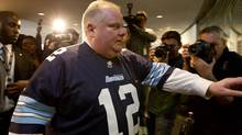 Mayor Rob Ford arrives at his office wearing an Argos jersey after leaving council chambers and prior to his press conference at City Hall in Toronto on November 14, 2013. (Deborah Baic/The Globe and Mail)