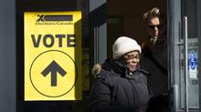 Voters leave a station in Montreal on Oct. 19, 2015. Prime Minister Justin Trudeau promised during last year's federal-election campaign that the election would be the last under the first-past-the-post system. He now faces pressure to see that promise through. (Kevin Van Paassen/Bloomberg)