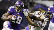 In this Dec. 1, 2013, file photo, Minnesota Vikings running back Adrian Peterson, left, tries to break a tackle from Chicago Bears free safety Chris Conte during the fourth quarter of an NFL football game in Minneapolis. (Ann Heisenfelt/AP)