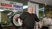 Toronto Mayor Rob Ford jokes around while standing on a scale during a weigh in marking the start of a 6 month weight loss challenge that Ford and his brother Doug are attempting in Toronto on Monday, January 16, 2012. Ford weighed in at 330lbs and hopes to loose 50lbs by June 18th. (Pawel Dwulit for The Globe and Mail/Pawel Dwulit for The Globe and Mail)