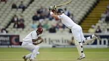 England's Kevin Pietersen (R) hits a four as West Indies' Adrian Barath takes evasive action during the third cricket test match at Edgbaston cricket ground in Birmingham June 10, 2012. (PHILIP BROWN/REUTERS)