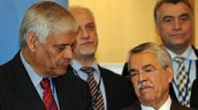 OPEC Secretary-General Abdalla Salem El-Badri, left, chats with Saudi Oil Minister Ali al-Nuaimi (FAYEZ NURELDINE)