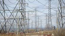 Hydro towers and power lines heading north from the Pickering generating station in Pickering, Ont. (Fred Lum/The Globe and Mail)