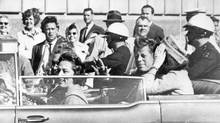 President John Kennedy, riding in the back seat approximately one minute before he was shot and killed in Dallas, Nov. 22, 1963. (ASSOCIATED PRESS)
