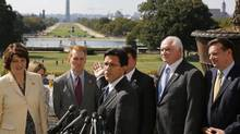 U.S. House Majority Leader Eric Cantor, middle, refers to the closed memorials and museums on the National Mall as he and Representative Cathy McMorris Rogers lead House Republicans in a news conference at the U.S. Capitol in Washington on Oct. 2, 2013. (JONATHAN ERNST/REUTERS)