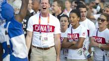 Chef de Mission Mark Tewksbury enthusiastically sings 'We are the Champions' by British rock group Queen during a welcome ceremony at the Athlete's Village in London, England Wednesday, July 25/2012. (Kevin Van Paassen/The Globe and Mail)