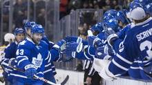 Toronto Maple Leafs' Nazem Kadri (left) skaes along the Leafs bench as he celebrates scoring against Boston Bruins during first period NHL action in Toronto on Saturday March 23, 2013. (Chris Young/THE CANADIAN PRESS)