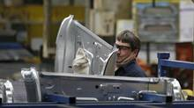 In this April 4, 2012, photo, an auto worker at the Ford Stamping Plant in Chicago Heights, Ill. (Charles Rex Arbogast/AP)