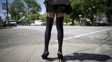 There is a ready answer to the question of why competition does not drive down sex work's rewards: If prostitutes make less, they choose a less risky line of work. (JONATHAN HAYWARD/THE CANADIAN PRESS)