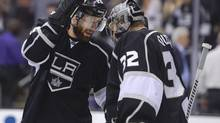 Los Angeles Kings centre Jarret Stoll congratulates goalie Jonathan Quick after the Kings defeated the Chicago Blackhawks 3-1 in Game 3 of the NHL hockey Stanley Cup playoffs Western Conference finals, Tuesday, June 4, 2013, in Los Angeles. (Mark J. Terrill/AP)