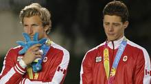 Canada's hockey players stand on the podium after winning the silver medal for the men's field hockey event at the Pan American Games in Guadalajara, Mexico, Saturday, Oct. 29, 2011. Canada lost the gold medal match 1-3 to Argentina. (AP Photo/Ricardo Mazalan) (Ricardo Mazalan/AP)