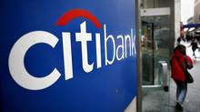 A customer exits a Citibank branch at 40th St. and Broadway in New York. (Craig Ruttle/AP)