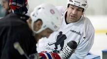 Washington Capitals Roman Hamrlik chats with Montreal Canadiens Travis Moen during an informal practice (Paul Chiasson/The Canadian Press)