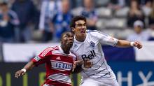 FC Dallas' Fabian Castillo, left, of Colombia, left, and Vancouver Whitecaps' Omar Salgado battle for control of the ball during the first half of an MLS soccer game in Vancouver, B.C., on Saturday April 21, 2012. (DARRYL DYCK/DARRYL DYCK/THE CANADIAN PRESS)