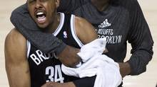 Brooklyn Nets forward Paul Pierce (left) officially signed with the Washington Wizards on July, 17, 2014. (Nathan Denette/THE CANADIAN PRESS)