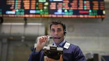 A trader is seen on the floor at the New York Stock Exchange after the opening bell in Lower Manhattan, New York May 14, 2013. (BRENDAN MCDERMID/REUTERS)