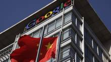 A Chinese flag flutters outside Google's China headquarters in Beijing (Ng Han Guan)
