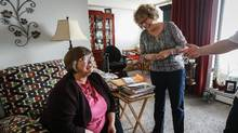 Janice Kraayenhof, right, pays her monthly visit to her sister-in-law, Bea, in her Welland, Ont., apartment. Ms. Kraayenhof provides long-distance care to Bea, who has Alzheimers. (Glenn Lowson for The Globe and Mail)