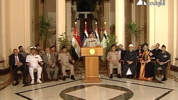 Lieutenant-General Abdel-Fattah el-Sissi, middle, is flanked by military and civilian leaders – including reform leader Mohamed ElBaradei, far left; Tamarod leader Mahmoud Badr, second left; the Grand Sheik of Al-Azhar, Ahmed el-Tayeb, third from right; and Pope Tawadros II, second from right – as he addresses the nation on Egyptian state television Wednesday, July 3, 2013. The armed forces ousted Egypt's first democratically elected president, Mohammed Morsi, after just a year in power. (ASSOCIATED PRESS)