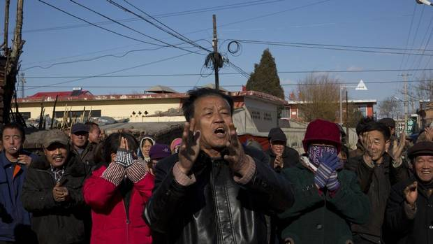 Villagers cheer as they welcome foreign journalists to Panguanying Village, Hebei Province, on Wednesday. (Adam Dean for The Globe and Mail)