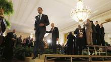 "U.S. President Barack Obama and Vice President Joe Biden walk from the stage, following remarks on the impending ""fiscal cliff"" talks with Congress, in the East Room of the White House in Washington. (JASON REED/REUTERS)"