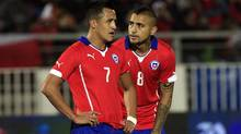 Chile's, Arturo Vidal, right and Alexis Sanchez, talk during an international friendly soccer against Northern Ireland, in Valparaiso, Chile, Wednesday, Jun 4, 2014. (Associated Press)
