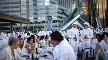 French culture embraces a close dining environment among strangers. On Aug. 30, an estimated 1,200 white-clad participants gathered for a pop-up picnic in Vancouver. (Rafal Gerszak/The Globe and Mail)