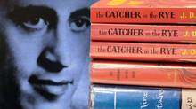 Copies of J.D. Salinger's classic novel 'The Catcher in the Rye' as well as his short stories volume 'Nine Stories' are seen at the Orange Public Library in Orange Village, Ohio. (Amy Sancetta/Amy Sancetta/AP)