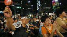 Protesters attend a protest rally in Hong Kong Sunday, Aug. 31, 2014. China's legislature's standing committee announced Sunday that all candidates must receive more than half of votes from a special nominating body to go before voters (Vincent Yu/AP)