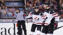 Canada defenceman Thomas Chabot (5) reacts after scoring against team Slovakia during second period IIHF World Junior Championships hockey action in Toronto on Tuesday, December 27, 2016. (Nathan Denette/THE CANADIAN PRESS)