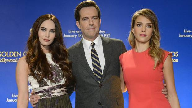 Actresses Megan Fox (L) and Jessica Alba (R) pose for photographers with actor Ed Helms at the announcement of nominations for the 70th annual Golden Globe Awards in Beverly Hills, California December 13, 2012. The awards will be presented on January 13, 2013. (PHIL McCARTEN/REUTERS)