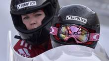 Canada's Kaillie Humphries, in front, and Chelsea Valois sit in their bobsled at a race in Winterberg, Germany, Saturday, Dec. 8, 2012. (Associated Press)